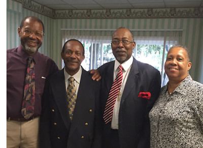 (l-r) Pastor Ron Washington, Curtis May, MacArthur Mickens and his wife, Fay